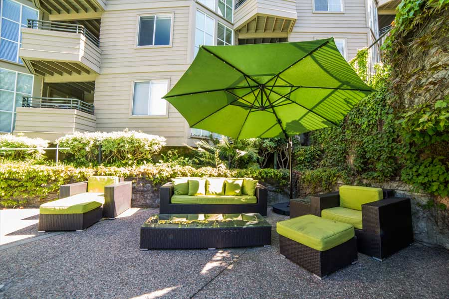 Patio area with umbrella and matching lawn furniture at our Walnut Creek, CA apartments.